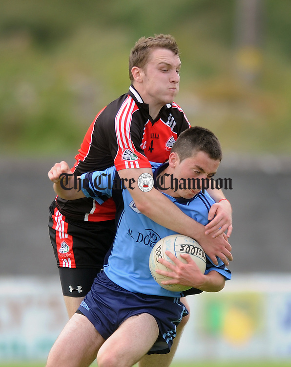 Caoimhin Donnellan runs into the challenge of Clondegad's Cormac Ryan. Photograph by Declan Monaghan