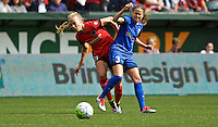 Portland, OR - Sunday, May 29, 2016: Portland Thorns FC midfielder Dagny Brynjarsdottir (11) and Seattle Reign FC defender Lauren Barnes (3) during a regular season National Women's Soccer League (NWSL) match at Providence Park.
