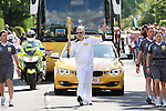 Pix: Shaun Flannery/shaunflanneryphotography.com...COPYRIGHT PICTURE>>SHAUN FLANNERY>01302-570814>>07778315553>>..19th June 2012..Drax Power Limited..The Olympic Torch Relay passes along Leeds Road, Selby in North Yorkshire..Peter Heald, a maintenance craftsman at Drax Power Station carries the torch.