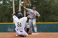 Detroit Tigers Anthony Pereira (68) attempts to turn a double play as Jeremias Portorreal (51) slides into second base during an Instructional League game against the Pittsburgh Pirates on October 6, 2017 at Pirate City in Bradenton, Florida.  (Mike Janes/Four Seam Images)