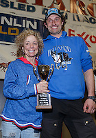 Thomas Waerner recieves the Jerry Austin Rookie of the year award from DeeDee Jonrowe at the finishers banquet in Nome on Sunday  March 22, 2015 during Iditarod 2015.  <br /> <br /> (C) Jeff Schultz/SchultzPhoto.com - ALL RIGHTS RESERVED<br />  DUPLICATION  PROHIBITED  WITHOUT  PERMISSION