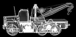 X-ray image of a tow truck (white on black) by Jim Wehtje, specialist in x-ray art and design images.