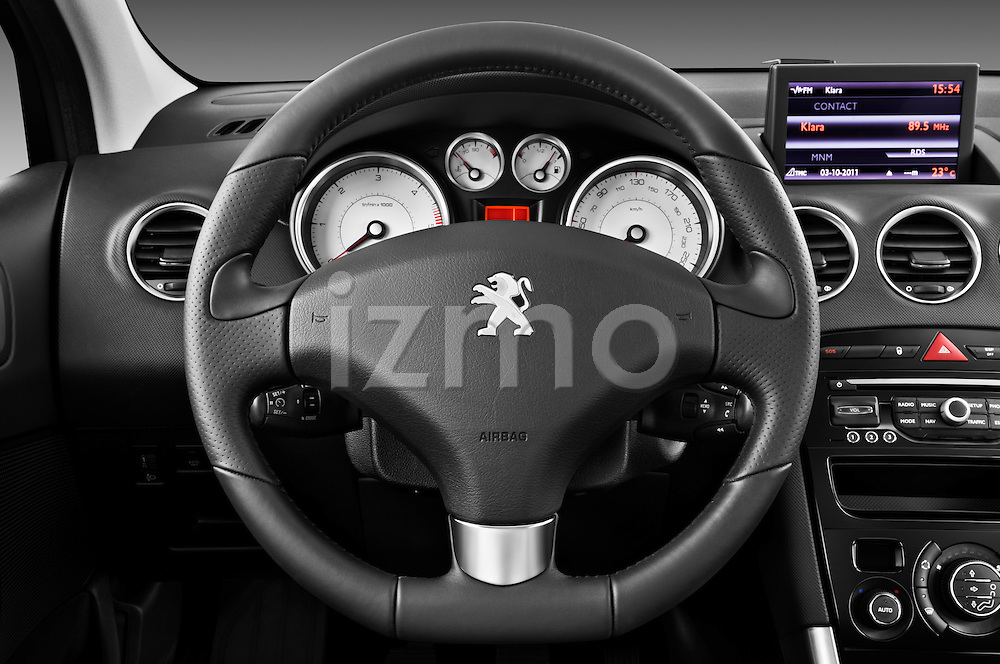 Steering wheel view of a 2011 Peugeot 308 5 Door Hatchback