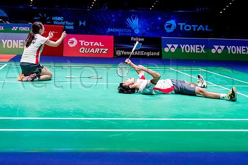 18th March 2018, Arena Birmingham, Birmingham, England; Yonex All England Open Badminton Championships; Yuta Watanabe (JPN) and Arisa Higashino (JPN) celebrate winning in the mixed doubles final against Zheng Siwei (CHN) and Huang Yaqiong (CHN)