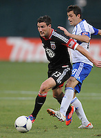 D.C. United forward Chris Pontius (13)  shields the ball from Montreal Impact midfielder Collen Warner (18)  D.C. United defeated Montreal Impact 3-0 at RFK Stadium, Saturday June 30, 2012.