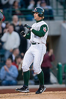 James Darnell #8 of the Fort Wayne Tin Caps crosses home plate after hitting a 2-run home run for the first hit by a Tin Cap player at Parkview Field April 16, 2009 in Fort Wayne, Indiana. (Photo by Brian Westerholt / Four Seam Images)