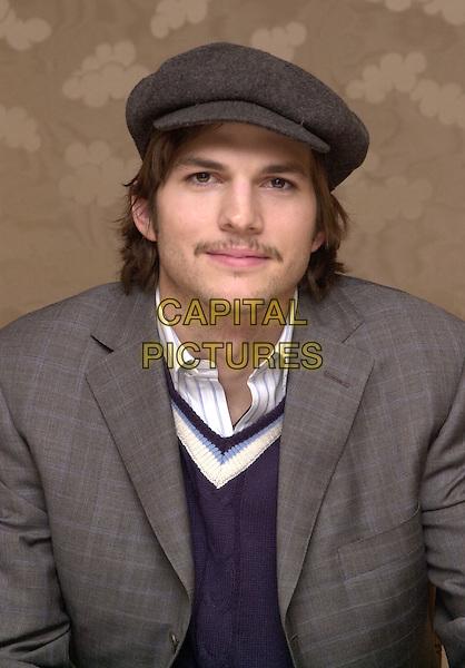 ASHTON KUTCHER.Los Angeles, 2004.headshot, portrait, mustache, hat, vest, striped collar, facial hair.www.capitalpictures.com.sales@capitalpictures.com.© Capital Pictures.