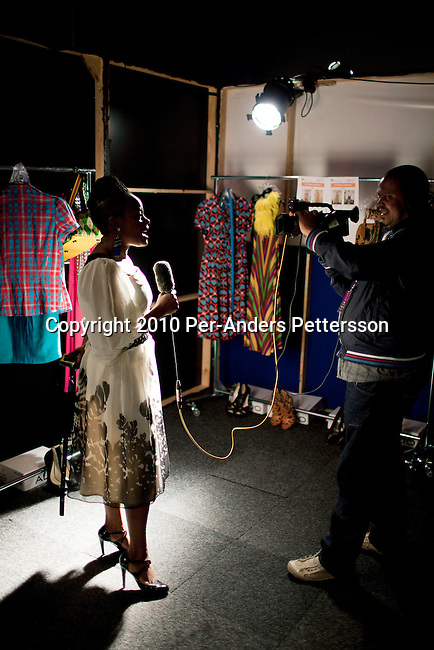 CAPE TOWN, SOUTH AFRICA - AUGUST 13: Nkhensani Nkosi (l) does an interview before a show with Stoned Cherrie, her fashion label, at the African Fashion International Cape Town fashion week on August 13, 2010, at the Cape Town International Convention Center, in Cape Town, South Africa. Stoned Cherrie is founded by Nkhensani Nkosi, age 37, a mother of four and a celebrated fashion designer, entrepreneur, television personality and an actress in South Africa. She launched her new collection Love Movement at this event. (Photo by Per-Anders Pettersson)