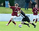 Fraserburgh's Mark Cowies tries to rugby tackle Linlithgow's Roddy Maclennan.