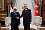 Turkish President Tayyip Erdogan and Palestinian President Mahmoud Abbas shake hands during a meeting at the Presidential Palace in Ankara, Turkey, August 28, 2017. Photo by Osama Falah