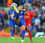 Daniel Drinkwater of Leicester City clears from Georgina Wijnaldum of Liverpool during the Premier League match at Anfield Stadium, Liverpool. Picture date: September 10th, 2016. Pic Simon Bellis/Sportimage