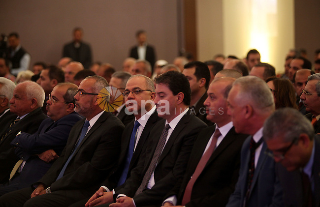 Palestinian businessmen participate in a conference of the Palestinian investors in the homeland and in the Diaspora, in the West Bank city of Ramallah, May 4, 2015. Photo by Shadi Hatem