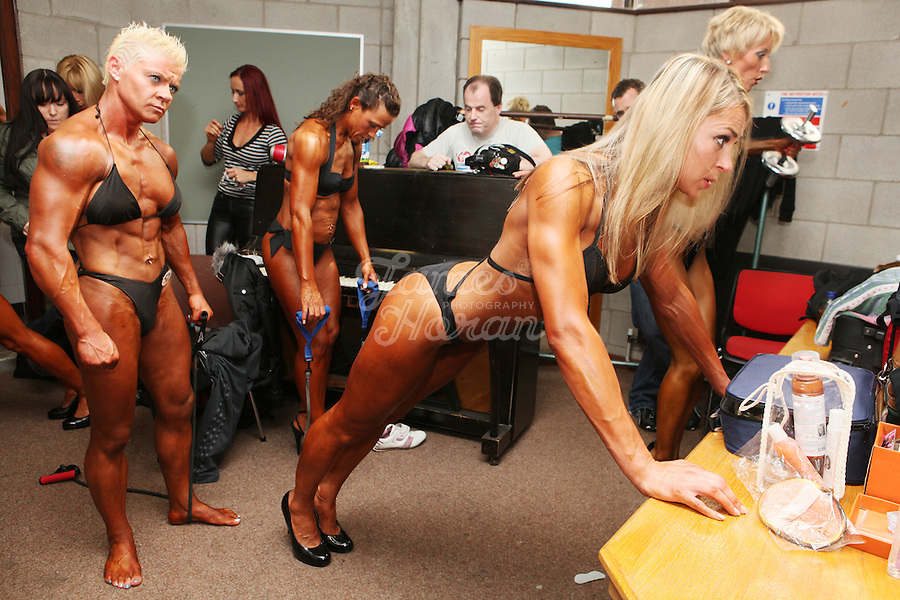 23/10/2010. Irish female physique and figure fitness national championships.  Contestants are pictured pumping up backstage during the female figure fitness category as part of the 2010 RIBBF national bodybuilding championships at the University of Limerick Concert Hall, Limerick, Ireland. Angela Mc Namara watches Ligita Kriksciunaite pump up. Picture James Horan.