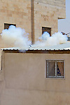 An Israeli army concussion grenade detonates on the roof of a Palestinian home as soldiers attempt to suppress a non-violent demonstration against Israel's controversial separation barrier in the West Bank town of Beit Jala, near Bethlehem on 11/07/2010.