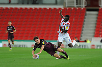 Daniel James of Swansea City is fouled by Peter Etebo of Stoke City during the Sky Bet Championship match between Stoke City and Swansea City at the Bet 365 Stadium in Stoke on Trent, England, UK. Tuesday 18 September 2018