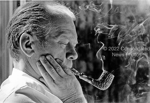 United States President Gerald R. Ford presents a study in thought as he puffs on his pipe at his desk in theOval Office in the White House on September 7, 1974. He was contemplating the question of amnesty for draft dodgers and deserters before making a nationwide announcement<br /> Mandatory Credit: David Hume Kennerly / White House via CNP
