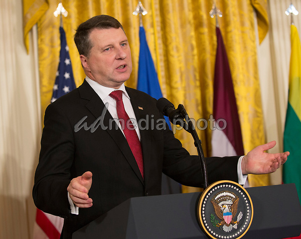 President Raimonds Vejonis of Latvia responds to a reporter's question at a Joint Press Conference hosted by United States President Donald J. Trump with the other Baltic States Heads of Government, President Dalia Grybauskaite of Lithuania, and President Kersti Kaljulaid of Estonia in the East Room of the White House in Washington, DC on Tuesday, April 3, 2018. Photo Credit: Chris Kleponis/CNP/AdMedia