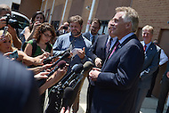 Washington, DC - May 24, 2016: Virginia Governor Terry McAuliffe answers questions from the media after visiting the District 36 Probation and Parole Office of the Virginia Department of Corrections, May 24, 2016. The visit comes amid information that the FBI is investigating aspects of McAuliffe's 2013 campaign for governor. (Photo by Don Baxter/Media Images International)