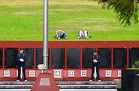 Monument commemorating the Falkland war Islas Malvinas on the Plaza San Martin Square, black marble plaques with names engraved of the soldiers in the war on red stone background, map of the island, two military honour guards in a park, young people sleeping on the grass behind. the Plaza San Martin Square renamed Plaza de la Fuerza Aerea or Plaza Fuerza Retiro Buenos Aires Argentina, South America
