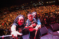 "MEDELLIN, COL AUG 06:  Marcelo Gomez holds his son 6 years old drummer Damian Gomez after he played during ""La Pestilencia"" 30th anniversary concert in Medellin Colombia on August 06, 2016 in Medellin. La Pestilencia is the first hardcore punk band  formed in colombia on 1986, they are currently based based in Los Angeles California (Photo by Carlos Alberto Montañez/VIEWpress)"