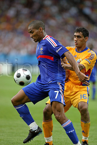 9 June 2008: French midfielder Florent Malouda shields the ball from Banel Nicolita during the UEFA Euro 2008 Group C game between France and Romania played at Letzigrund Stadion, Zurich. The game finished 0-0 Photo: Action Plus....080609 soccer football european championships player