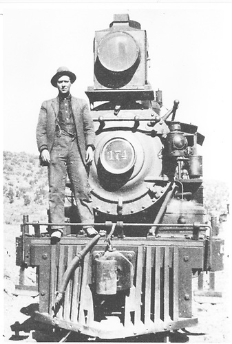 Engine #174 front view with man standing on front.<br /> D&amp;RGW  Embudo, NM