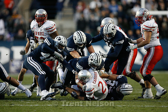 Trent Nelson  |  The Salt Lake Tribune.BYU defenders bring down New Mexico's Kasey Carrier during the first half,  BYU vs. New Mexico, Saturday, November 20, 2010.