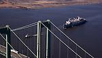 Aerial views of the USS Seattle Sailing under the Delaware Memorial Bridge