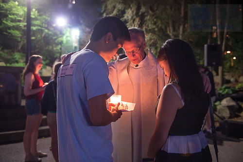 May 18, 2017; University of Notre Dame president, Rev. John Jenkins, C.S.C., blesses seniors at the Grotto before 2017 Commencement. (Photo by Barbara Johnston/University of Notre Dame)
