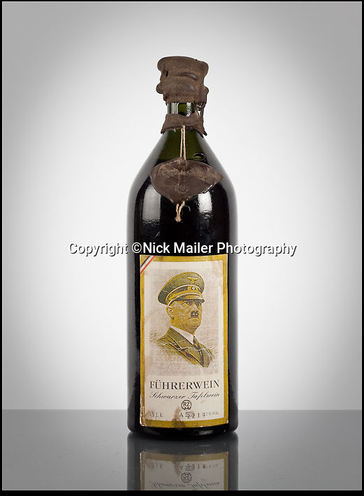 BNPS.co.uk (1202 558833)<br /> Pic: McTears/BNPS<br /> <br /> ***Please use full byline***<br /> <br /> Fancy a drop of old Adolf...<br /> <br /> This wine will leave a Nazi taste in your mouth - because it was made 71 years ago to celebrate the 54th birthday of evil Adolf Hitler.<br /> <br /> The rare unopened 1.5-litre bottle was made on Hitler's orders then handed out to to high ranking German officers to mark his birthday on April 20 1943.<br /> <br /> The self-obsessed dictator called the wine 'Fuhrerwein' - the leader's wine - and insisted the bottle's label carried a chilling picture of himself in uniform.<br /> <br /> A wax label on the bottle carries the symbol of the Nazi party - an eagle on top of a swastika.<br /> <br /> The wine itself is 12 per cent Schwarzer Tafelwein - 'black table wine' - thought to have been made in Germany and despite a wax seal on the bottle it would now be undrinkable.<br /> <br /> The bottle was given to a Hungarian prisoner of war by a German soldier and has remained in the same family ever since.<br /> <br /> 1943 may have been a good year for wine but it was a bad year for Hitler, as Allied forces turned the tables against the Nazis in Europe and on the Eastern Front.