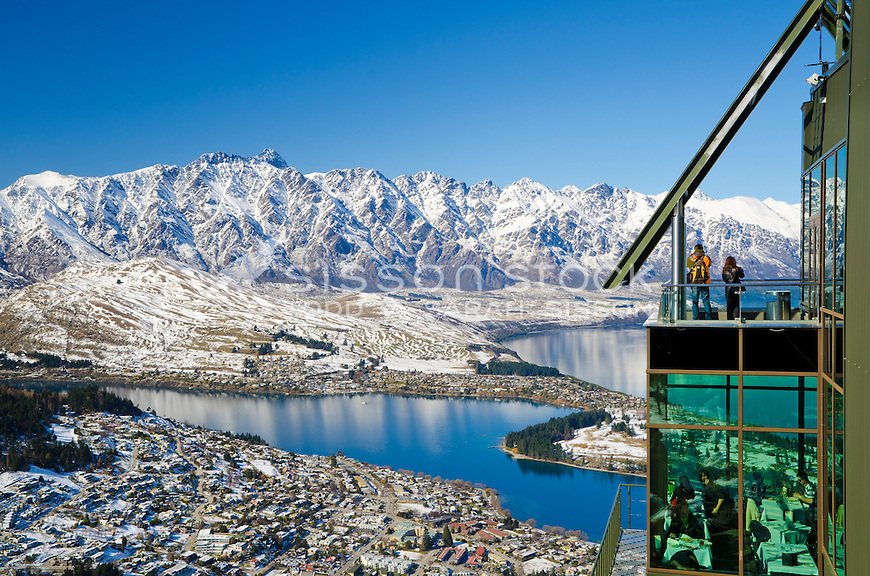 Tourists on viewing platform at Skyline Gondola, the Remarkables, Lake Wakatipu and Queenstown , snow, South Island, New Zealand
