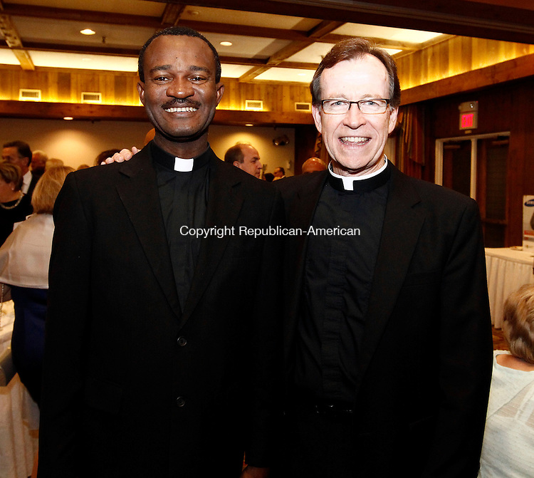 Southbury, CT- 18 October 2013-101813CM12-  Social Moments, left to right Father Jean Francois Tristant, from Our Lady of Seven Sorrows, (twin parish to Sacred Heart Church of Waterbury in Haiti) and Father Joe Donnelly of Sacred Heart Church during The Seeds of Hope dinner and auction at the Heritage Hotel in Southbury.  Proceeds from the event will benefit the ministry to Haiti at Sacred Heart Church.     Christopher Massa Republican-American