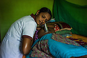Mathumita inspects Tuvarny before she leaves for the hospital as part of the pre-natal programme during the field visits in Punaineeravi village in Kilinochchi in Northern Sri Lanka. Photo: Sanjit Das/Panos