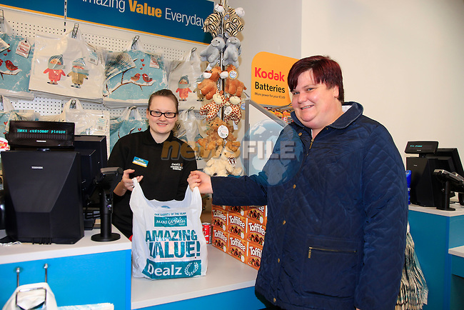 Enda Hynes first customer through the tills at the opening of the Dealz new store in Thomas Street, Dublin.<br /> <br /> Picture Newsfile/Professional Images