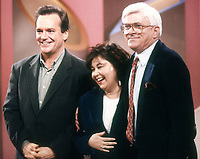 Tom Arnold and Roseanne Barr with Phil Donahue on the Phil Donahue show in 1992. Credit: Adam Scull/PHOTOlink.net /MediaPunch