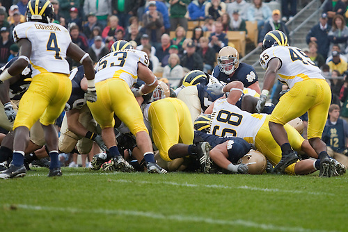 Notre Dame quarterback Dayne Crist (#10) dives for endzone during NCAA football game between the Notre Dame Fighting Irish and the Michigan Wolverines.  Michigan defeated Notre Dame 28-24 in game at Notre Dame Stadium in South Bend, Indiana.