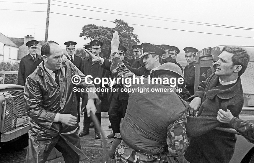 Prominent loyalist Major Ronald Bunting, left, and Rev William McCrea, a minister in the Free Presbterian Church, founded by Rev Ian Paisley, tangle with a British soldier and members of the RUC  blocking an Orangemen's parade defying a N Ireland Government parade ban preventing them marching in Dungiven, Co Londonderry, UK,  Dungiven is a strongly republican town and if the parade had proceeded would almost certainly have led to serious clashes. Ref: 19710613220b<br /> <br /> Copyright Image from Victor Patterson,<br /> 54 Dorchester Park, Belfast, UK, BT9 6RJ<br /> <br /> t: +44 28 90661296<br /> m: +44 7802 353836<br /> e1: victorpatterson@me.com<br /> e2: victorpatterson@gmail.com<br /> <br /> For my Terms and Conditions of Use go to<br /> www.victorpatterson.com