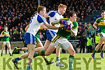 Kerrys David Moraan tears through the Monaghan defencerr Kieran Hughes  in Fitzgerald Stadium on Sunday