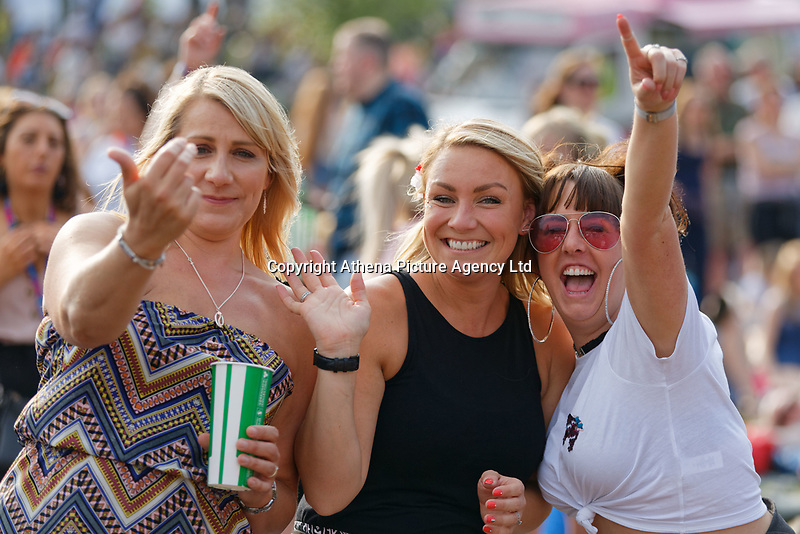 Pictured: Three women enjoy the concert. Saturday 26 May 2018<br /> Re: BBC Radio 1 Biggest Weekend at Singleton Park in Swansea, Wales, UK.