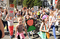 Pictured: Saturday 17 September 2016<br /> Re: Roald Dahl&rsquo;s City of the Unexpected has transformed Cardiff City Centre into a landmark celebration of Wales&rsquo; foremost storyteller, Roald Dahl, in the year which celebrates his centenary.<br /> Protesters, in support of the Giant Peach pictured on Westgate Street, Cardiff.