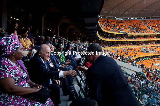 JOHANNESBURG, SOUTH AFRICA - FEBRUARY 10: FIFA president Sepp Blatter relaxes in the presidential suite with many dignitaries during the final of Africa's Cup at Soccer City stadium on February 10, 2013 in Johannesburg, South Africa. Mr. Blatter visited South Africa to watch the final game of the CAP, Africa's Cup of Nations between Nigeria and Burkina Faso. (Photo by Per-Anders Pettersson)