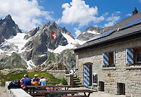Switzerland, Canton Uri, at Sustenpass Road - border between cantone Bern + Uri: Sustli mountain hut, Fuenffingerstock mountains with peaks Wendenhorn und Wasenhorn (f.l.t.r.)
