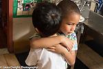 Education Preschool 3-4 year olds classroom scenes empathy boy giving sad boy a hug