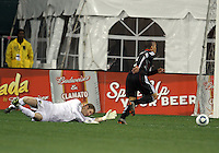 Charlie Davies#9 of D.C. United breaks away from Will Hesmer#1 of the Columbus Crew on his way to score his second goal during the opening match of the 2011 season at RFK Stadium, in Washington D.C. on March 19 2011.D.C. United won 3-1.