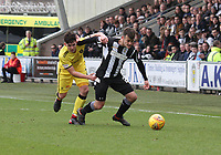 Danny Mullen gets the better of Declan Gallagher in the St Mirren v Livingston Scottish Professional Football League Ladbrokes Championship match played at the Paisley 2021 Stadium, Paisley on 14.4.18.