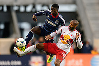 Thierry Henry (14) of the New York Red Bulls battles for the ball with Jalil Anibaba (6) of the Chicago Fire .The New York Red Bulls defeated the Chicago Fire 5-2 during a Major League Soccer (MLS) match at Red Bull Arena in Harrison, NJ, on October 27, 2013.