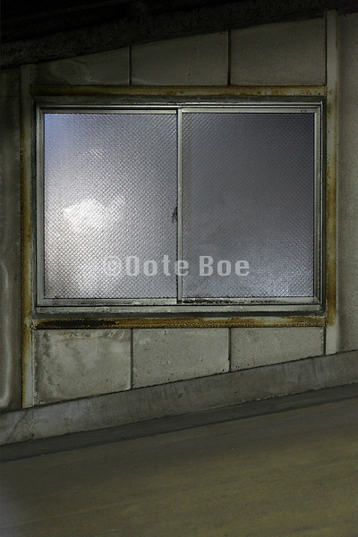 dirty window in parking garage at night