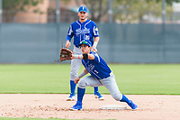 Team Italy second baseman Ricardo Paolini (1) and Mattia Mercuri (20) warm up before an exhibition game against the Oakland Athletics at Lew Wolff Training Complex on October 3, 2018 in Mesa, Arizona. (Zachary Lucy/Four Seam Images)