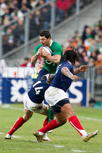 13 Februray 2010: Robert Kearney of Ireland is tackled by Vincent Clerc of France during the six nations match won 33-10 by France over Ireland at the Stade de France stadium in Saint-Denis, near Paris, France..Photo: Christophe Elise/ACTIONPLUS- EDITORIAL USE ONLY