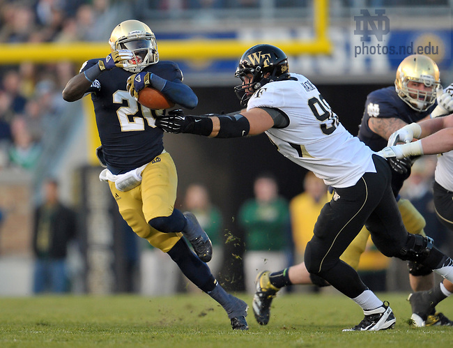 Nov. 17, 2012; Cierre Wood evades a Wake Forest tackler.